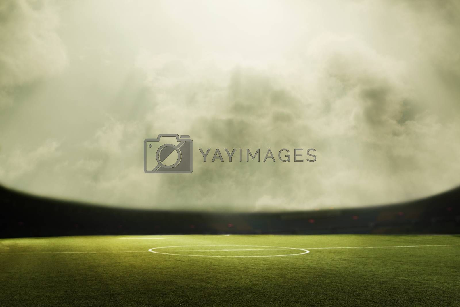 Digital composit of soccer field and cloudy sky