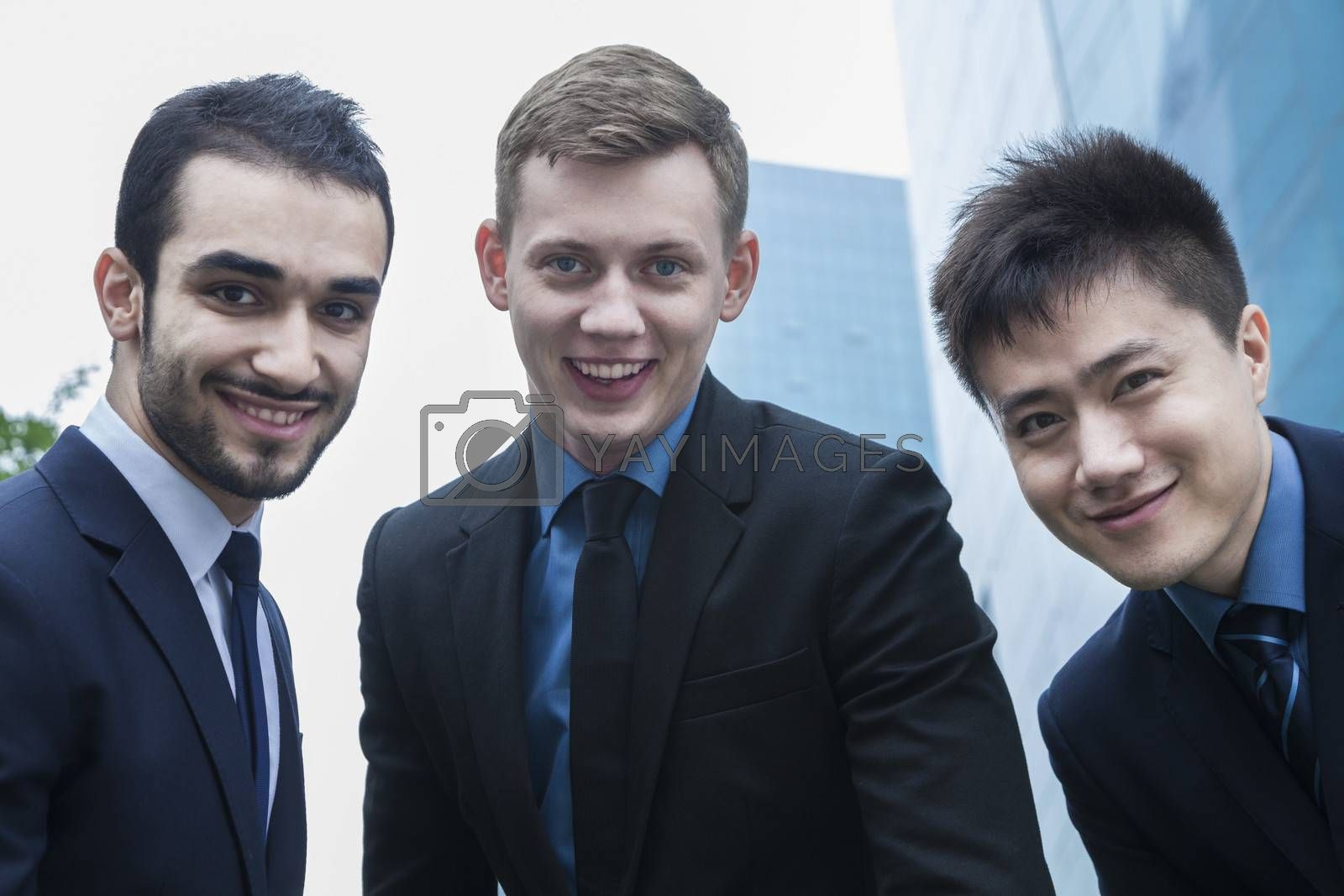 Portrait of three smiling businessmen, outdoors, business district  by XiXinXing