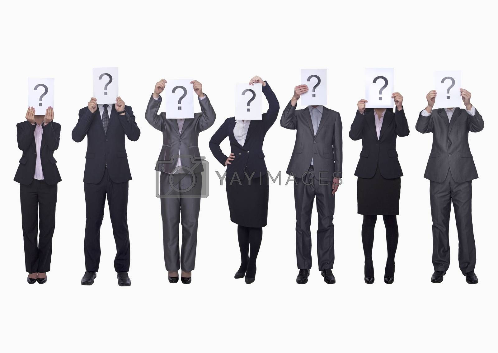 Medium group of business people in a row holding up paper with question mark, obscured face, studio shot by XiXinXing