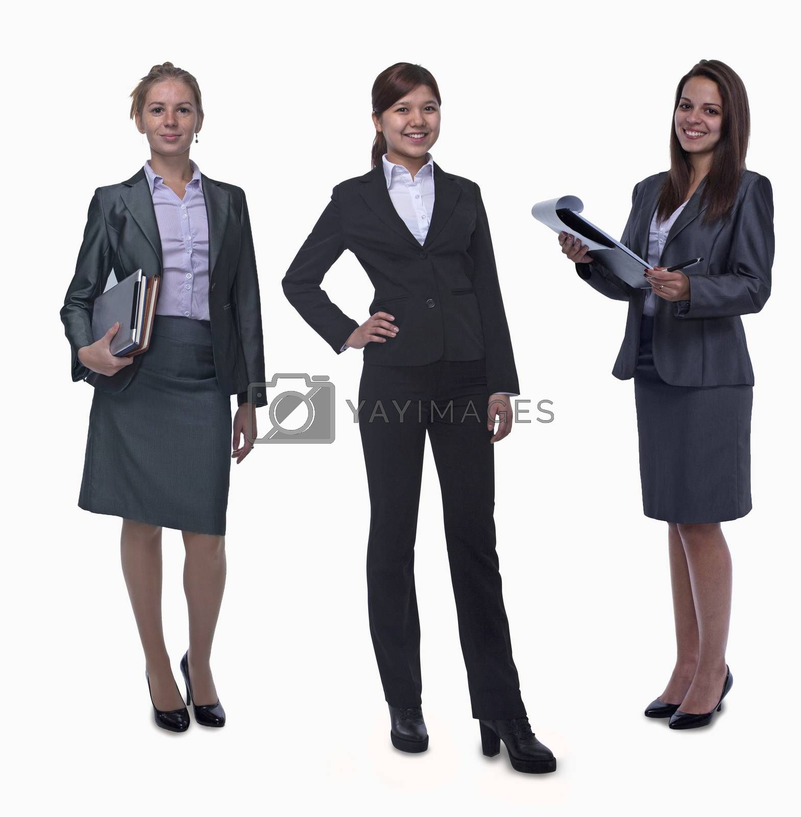 Portrait of three young smiling businesswomen, looking at camera, studio shot