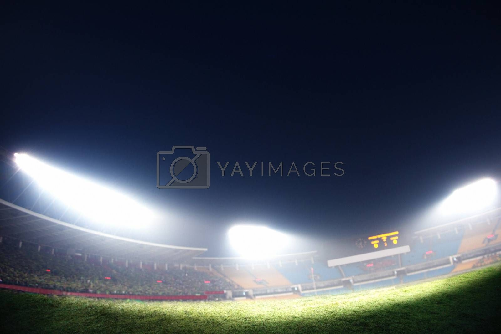 Digital composit of soccer field and night sky