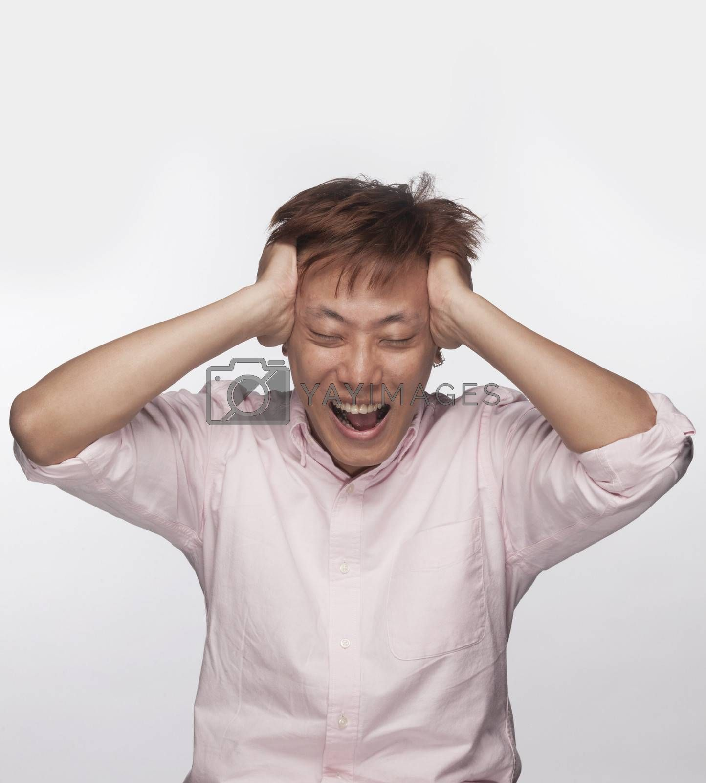Frustrated man with hands on head and mouth open, studio shot by XiXinXing