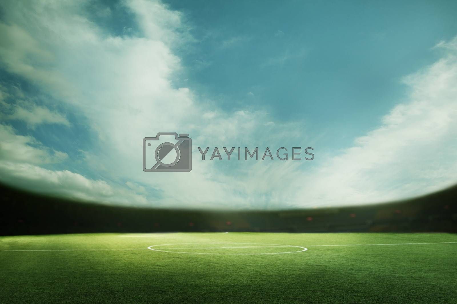 Digital coposit of soccer field and blue sky