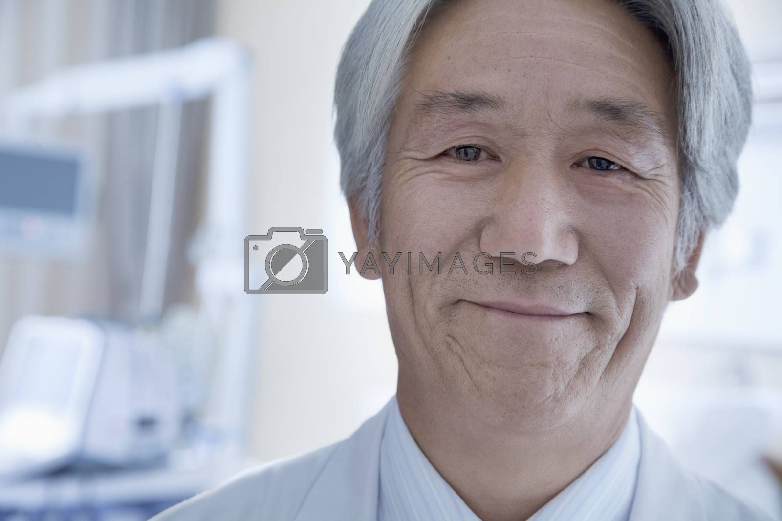 Close-up portrait of mature male doctor in the hospital