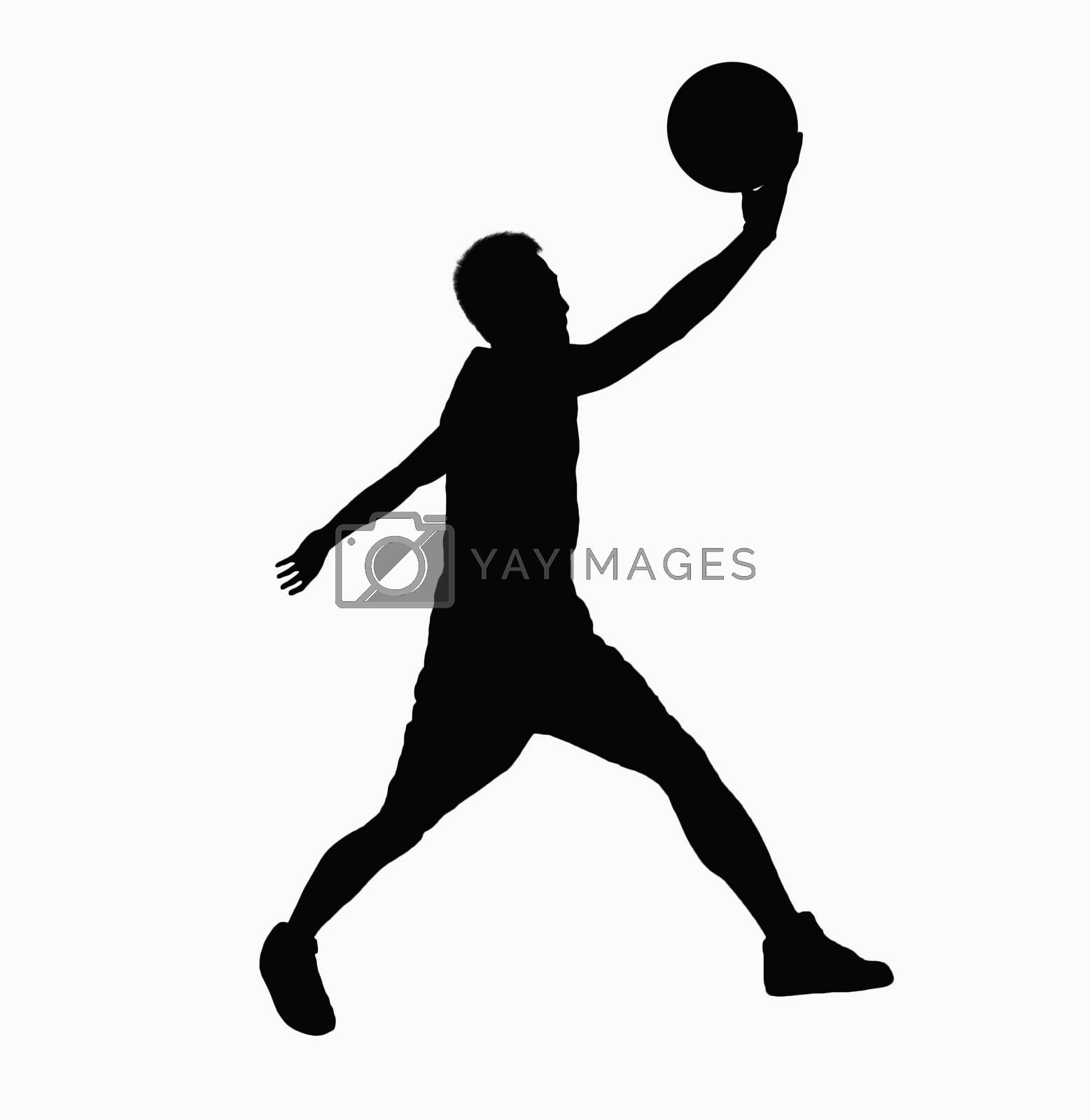 Silhouette of basketball player jumping with ball.