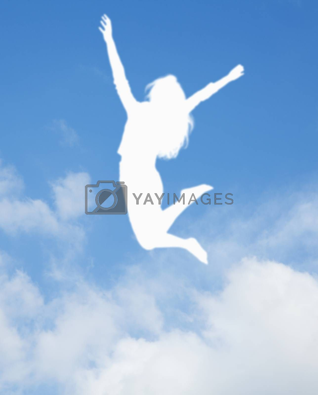 Silhouette of young woman jumping and cheering, arms in the air