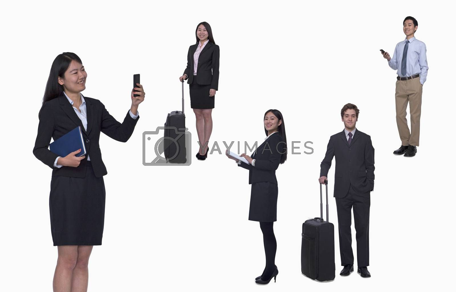Group of business people working, taking photos, texting, studio shot, full length