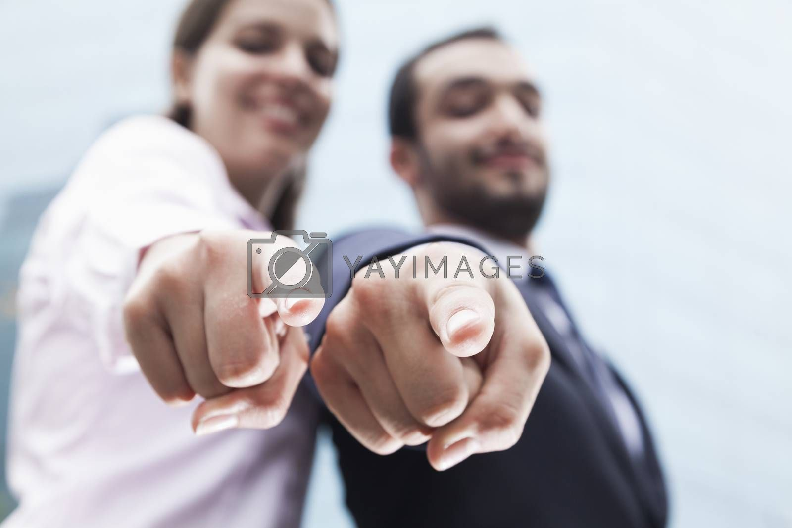 Close-up of two business people's fingers pointing at camera