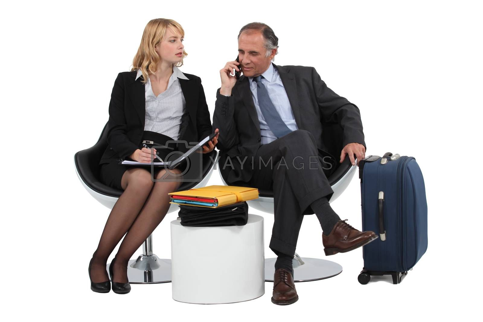 Two business people waiting