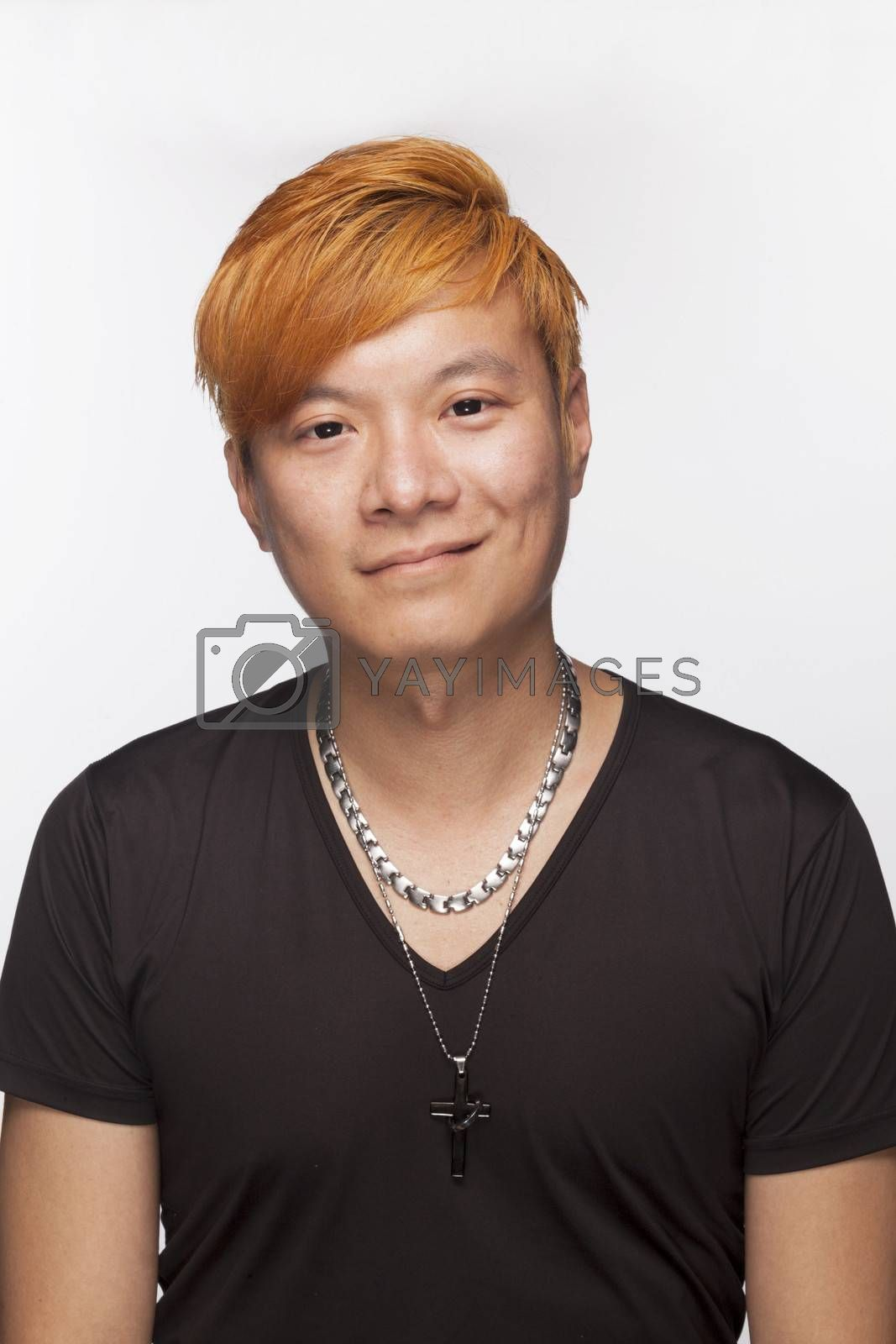 Portrait of smiling young man with orange hair