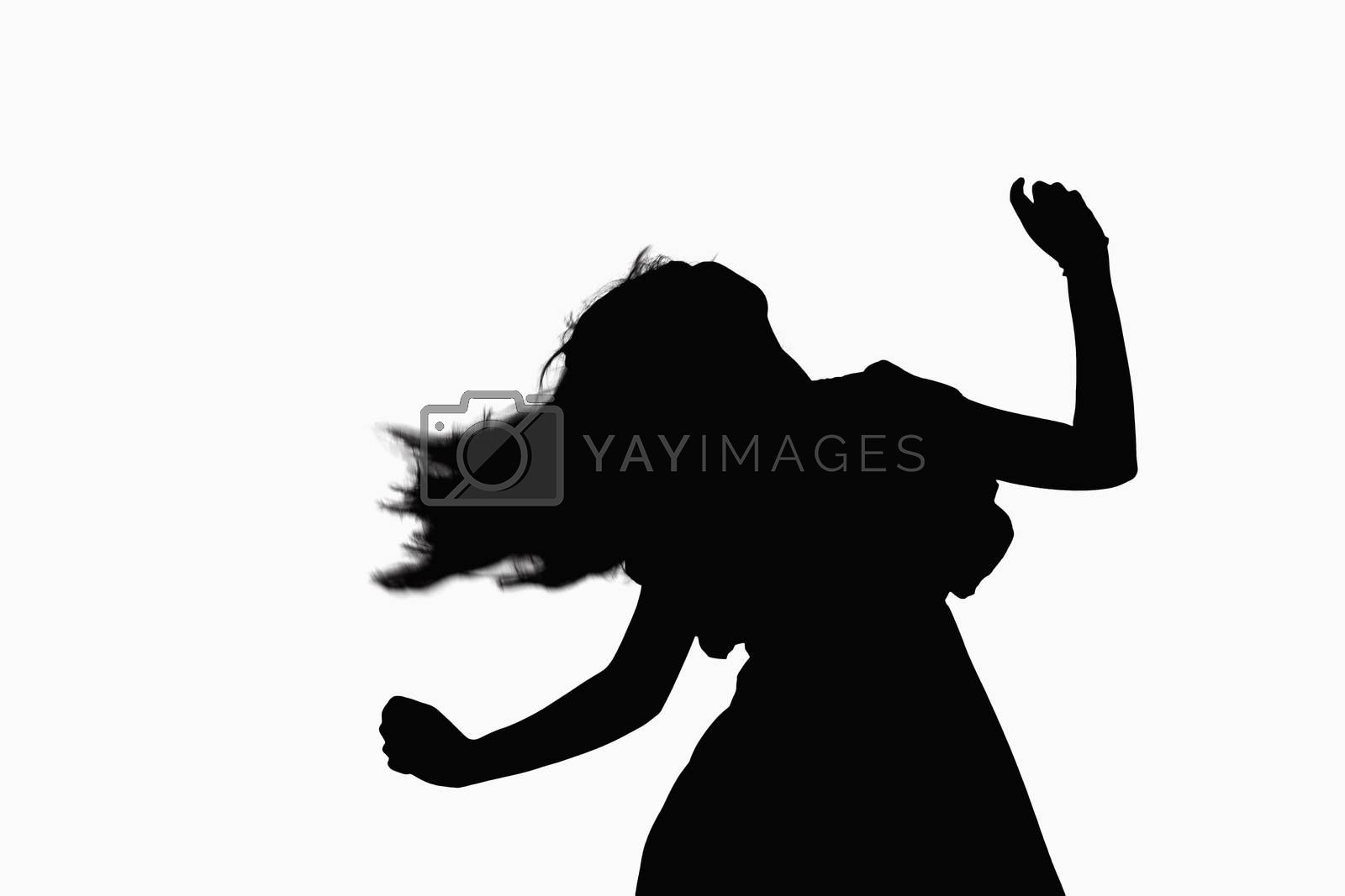 Silhouette of woman dancing.