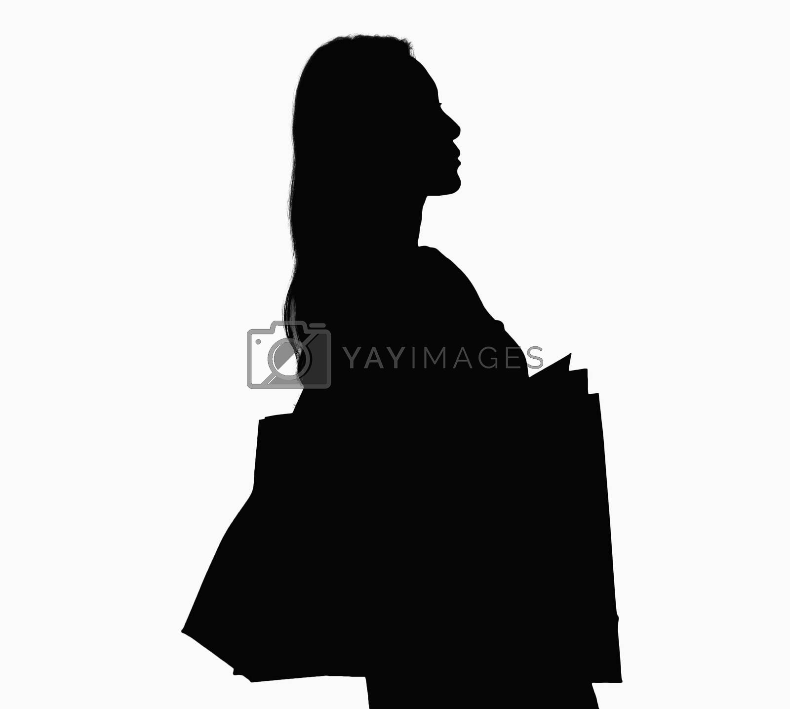 Silhouette of woman with shopping bags.