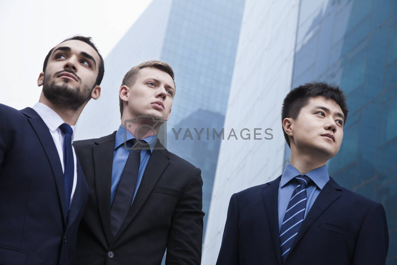 Portrait of three serious businessmen, outdoors, business district  by XiXinXing
