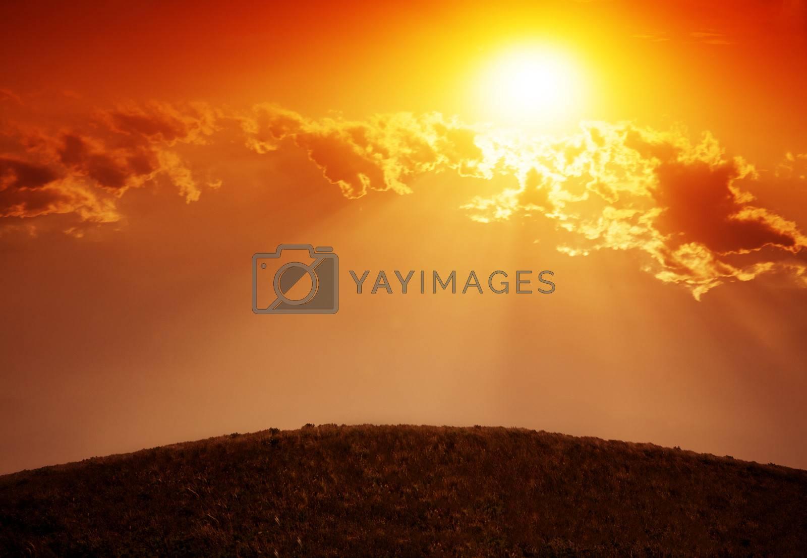 Landscape with sun shining through clouds. by XiXinXing