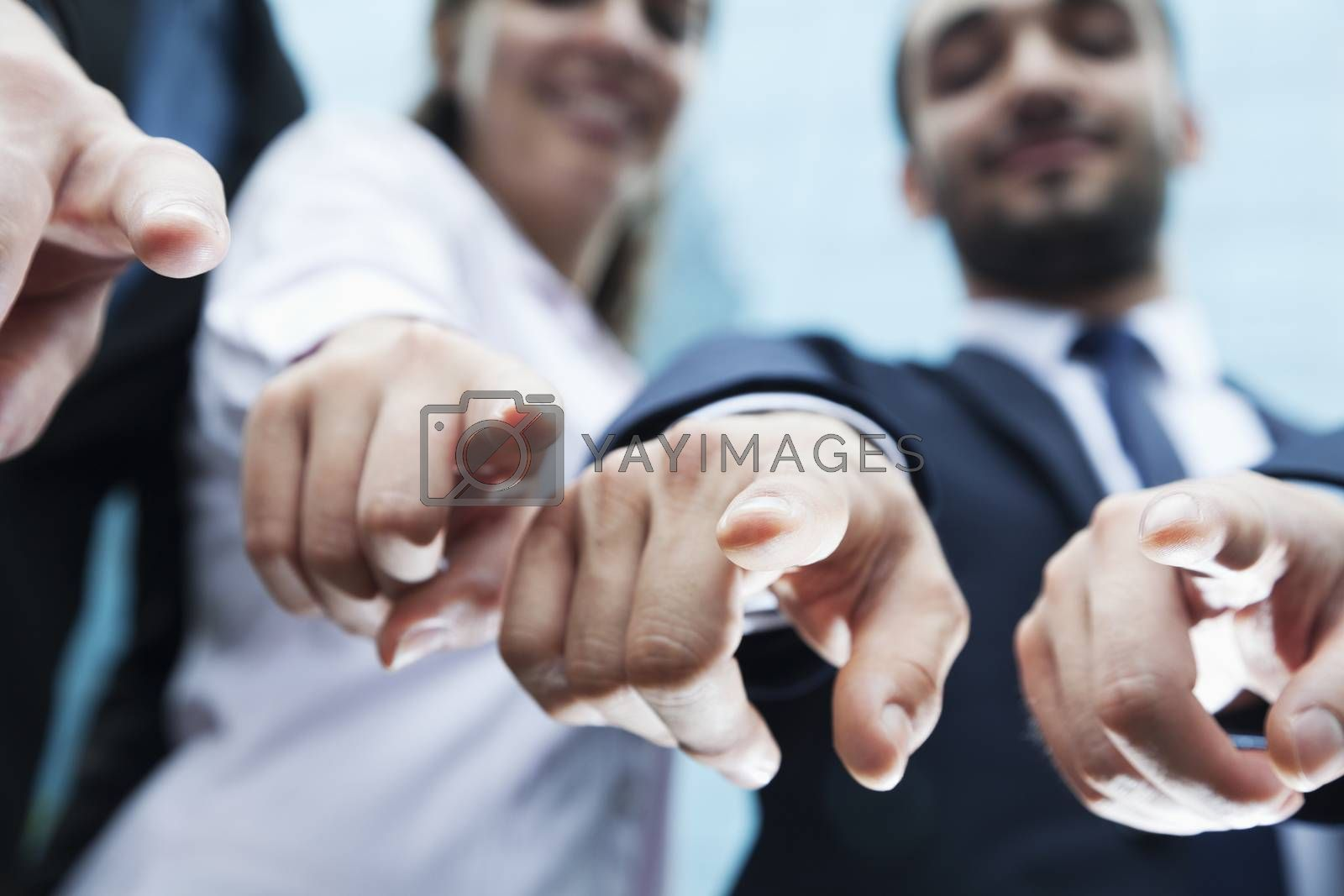 Close-up of four business people's fingers pointing at camera by XiXinXing