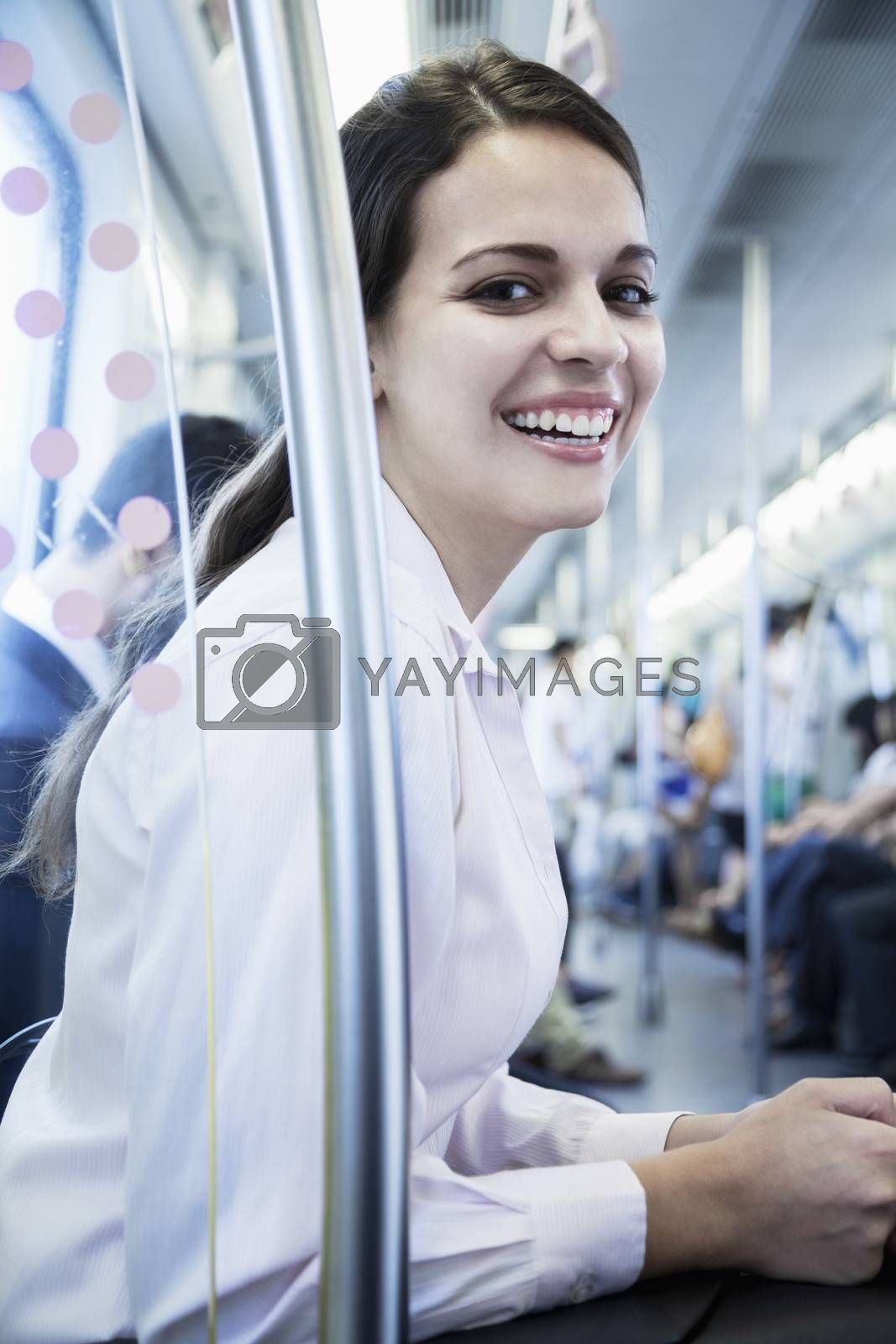 Portrait of young businesswoman sitting on the subway and looking at the camera by XiXinXing