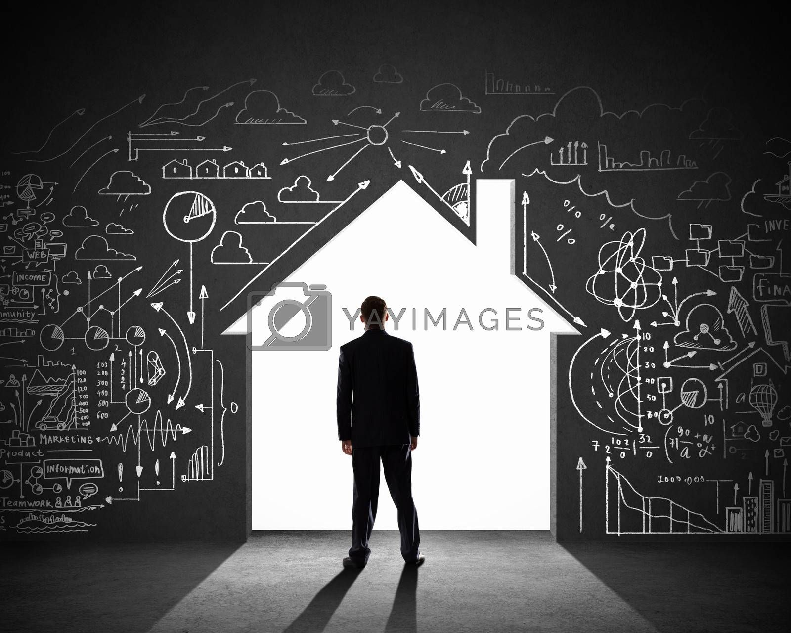Silhouette of businessman against black wall. Construction concept