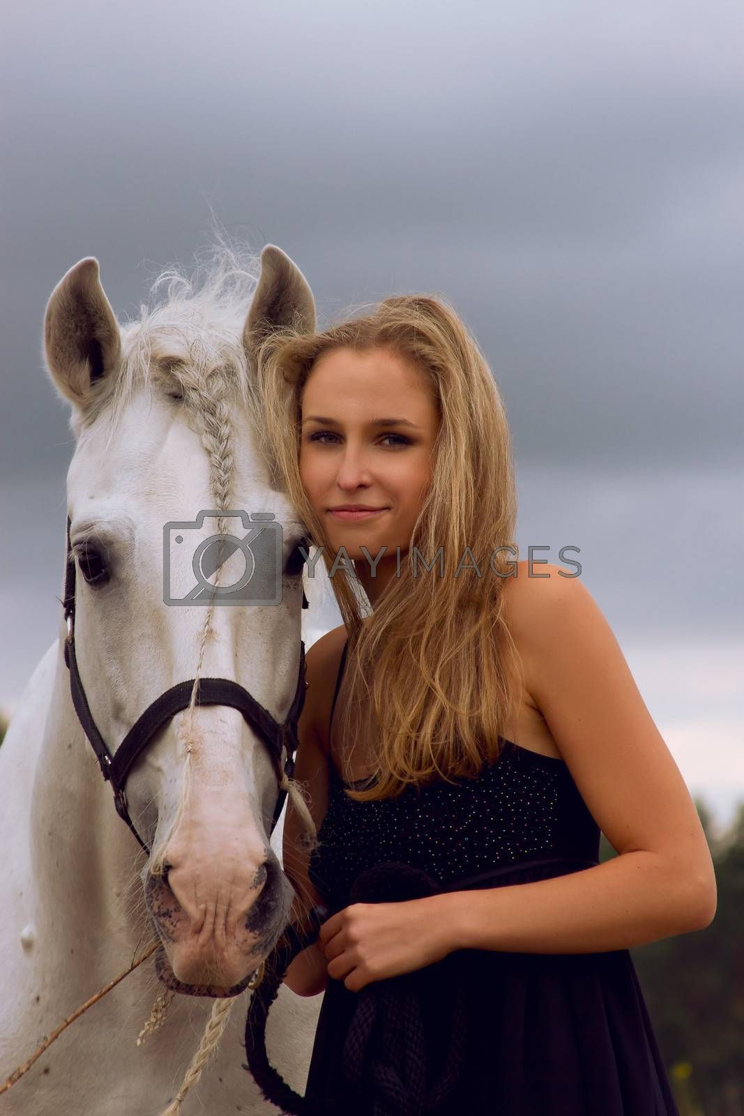 Blond girl with white horse