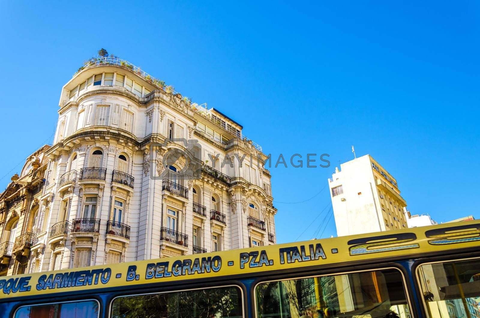 Old French style architecture in San Telmo neighborhood of Buenos Aires with a bus passing below