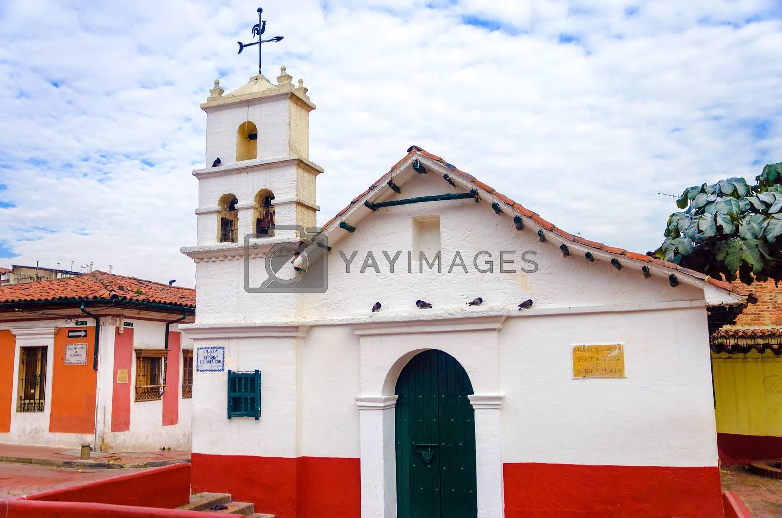 Old white historic church in La Candelaria neighborhood of Bogota, Colombia