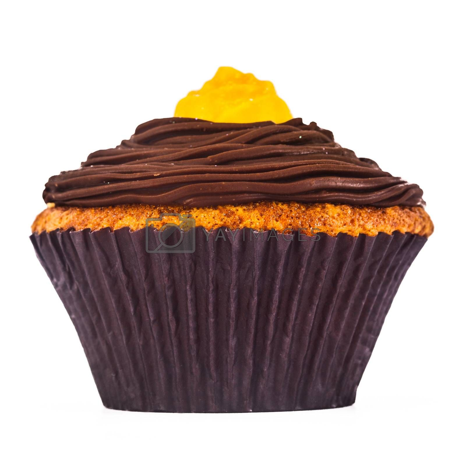 A gorgeous and delicious chocolate and carrot cupcake isolated on a white background.
