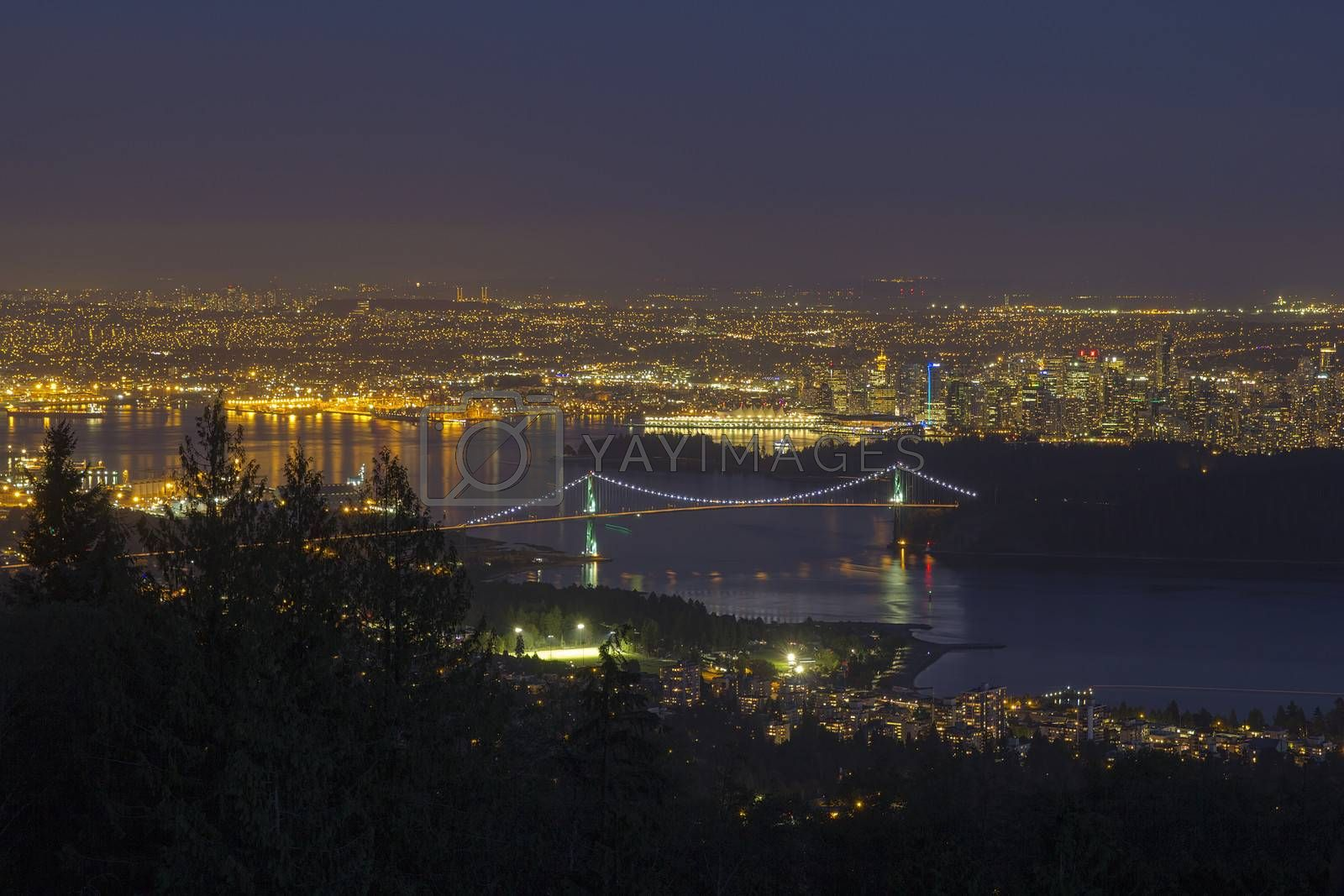 Vancouver BC Canada Cityscape with Stanley Park and Lions Gate Bridge Over Burrard Inlet at Evening Blue Hour