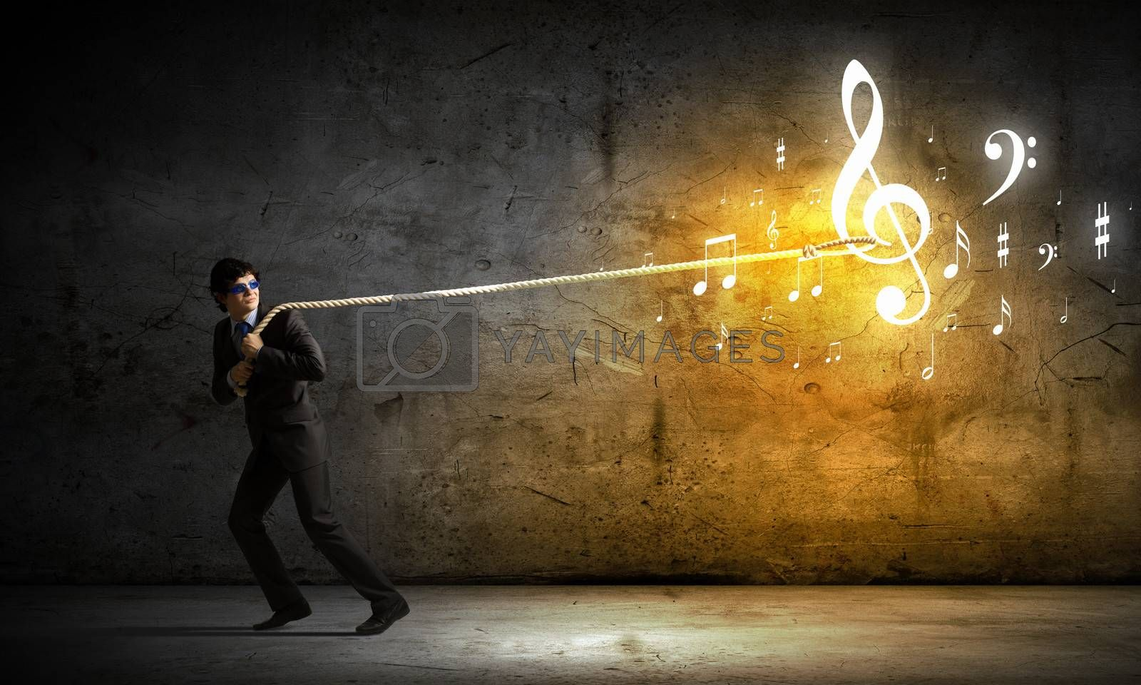 Image of young man pulling clef with rope