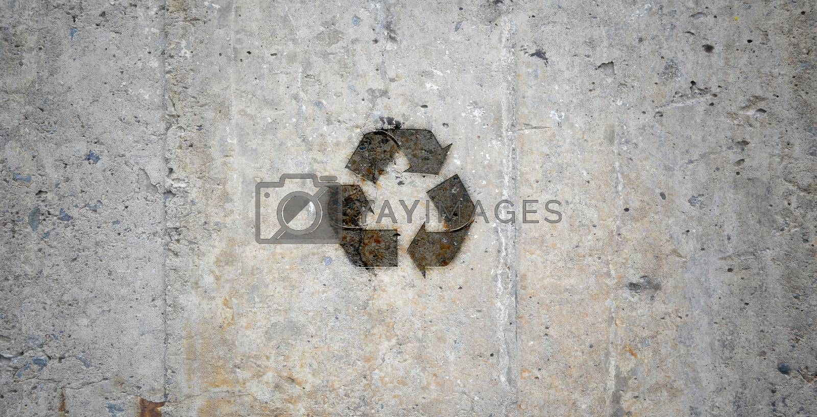 Grey stone wall with recycling symbol. Ecology idea