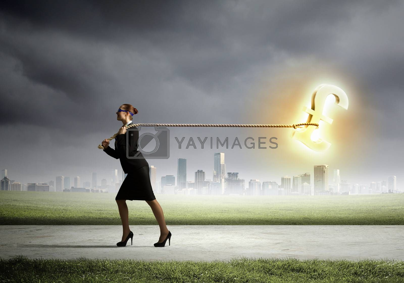 Image of businesswoman pulling pound sign with rope