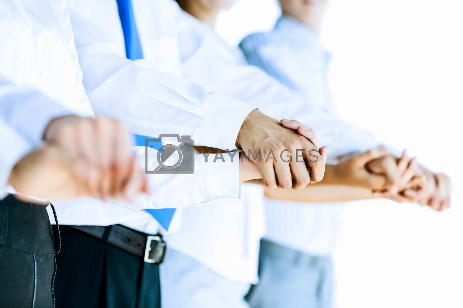 Image of group of businesspeople holding arms together. Teamwork