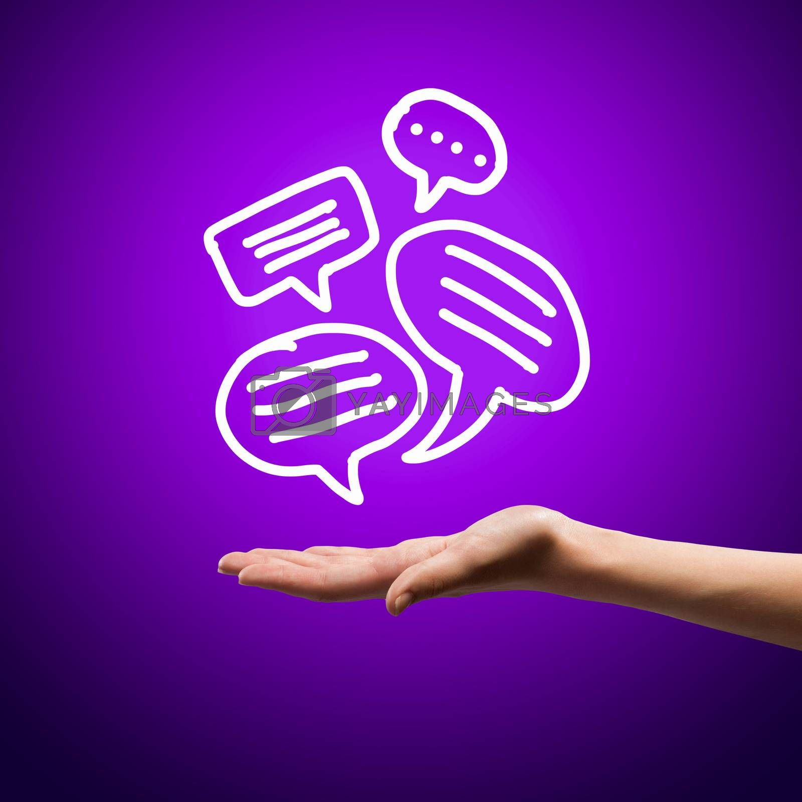 Close up image of human hand holding speech bubbles