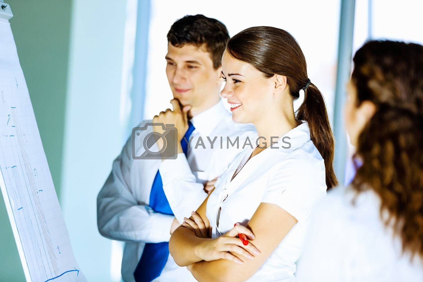 Image of business people at meeting discussing project
