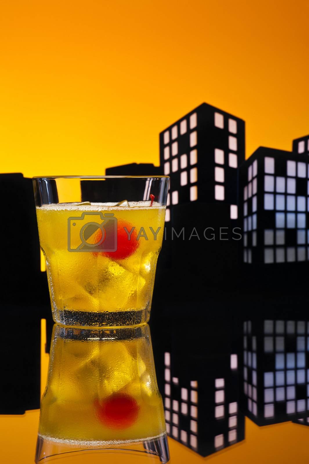 Skrew Driver cocktail in city skyline setting