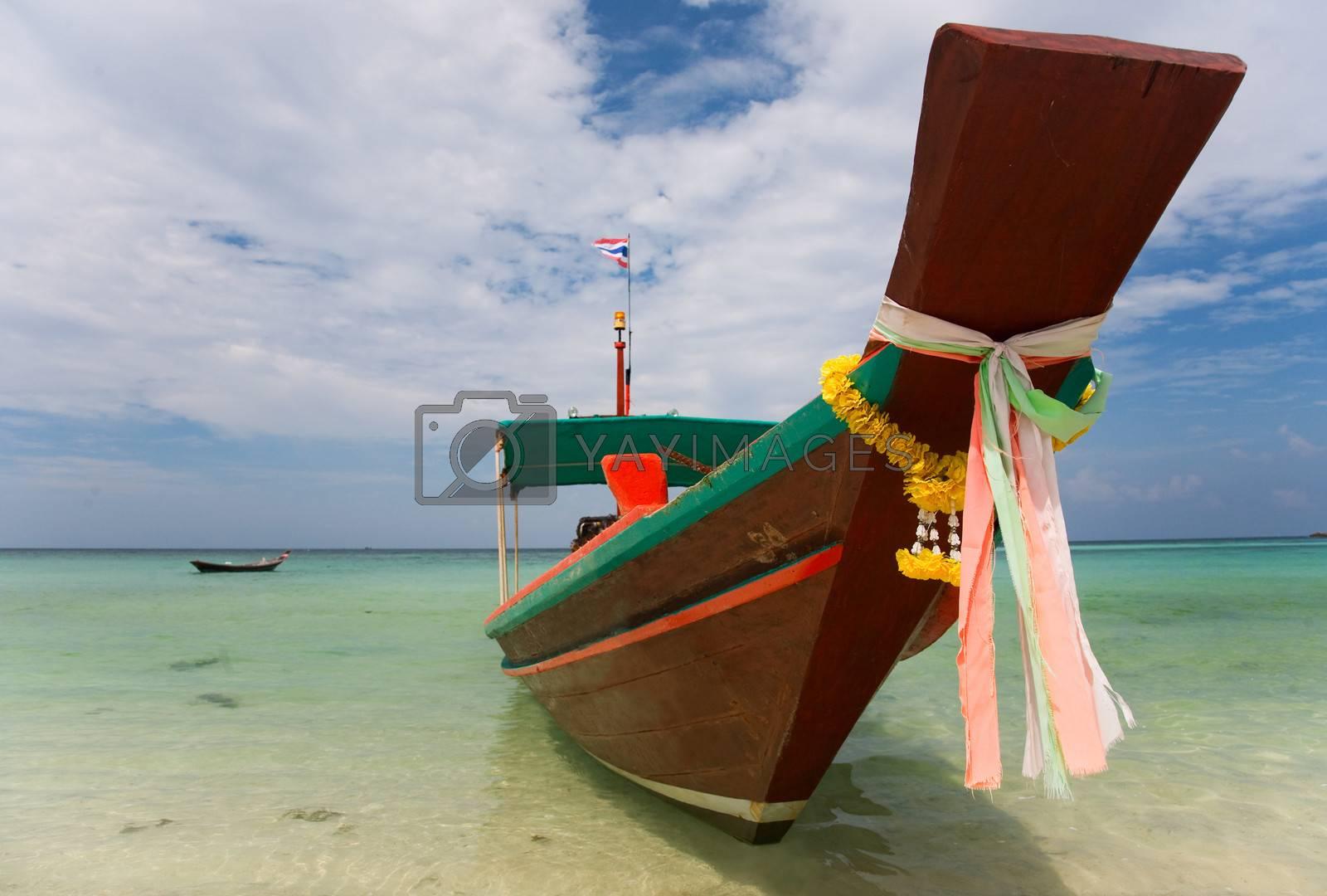 A Long Tail Boat on Haad Salat Beach in Koh Pangan, Thailand
