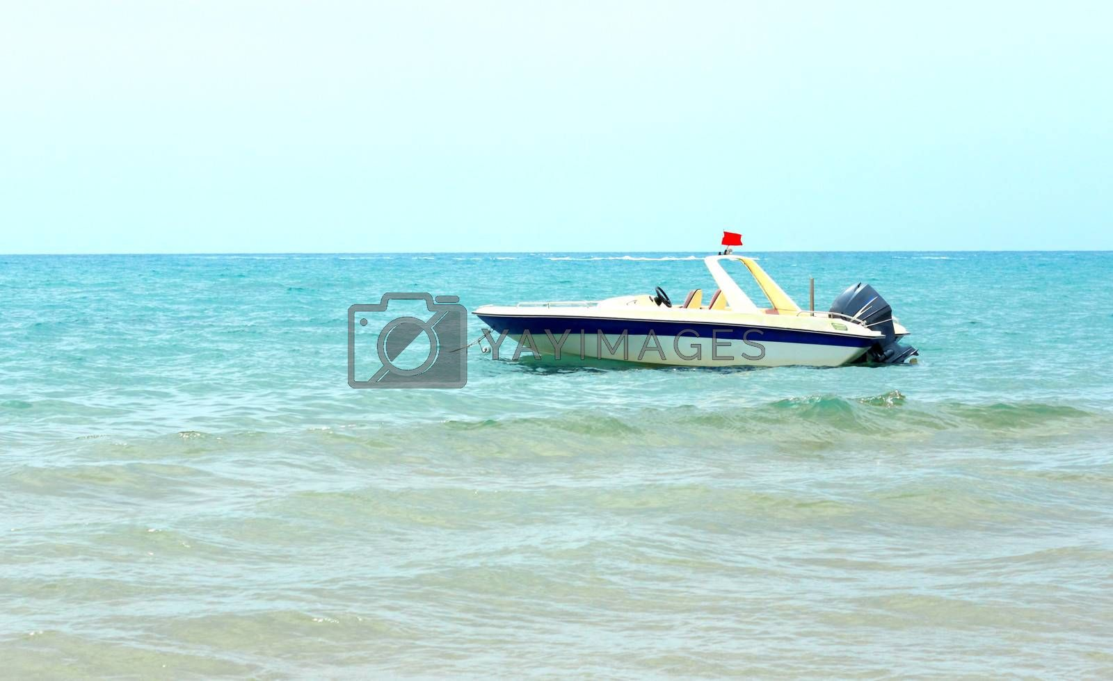 The small boat for sea trips in the coastal waters near the beach at the resort.
