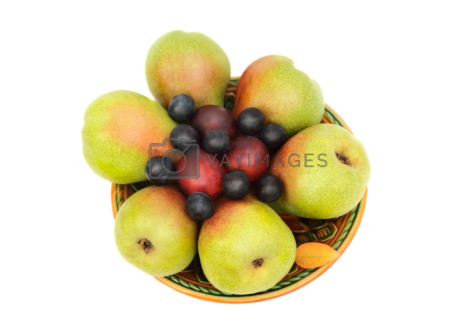 Large ripe pears, plums on a ceramic plate. Presented on a white background.
