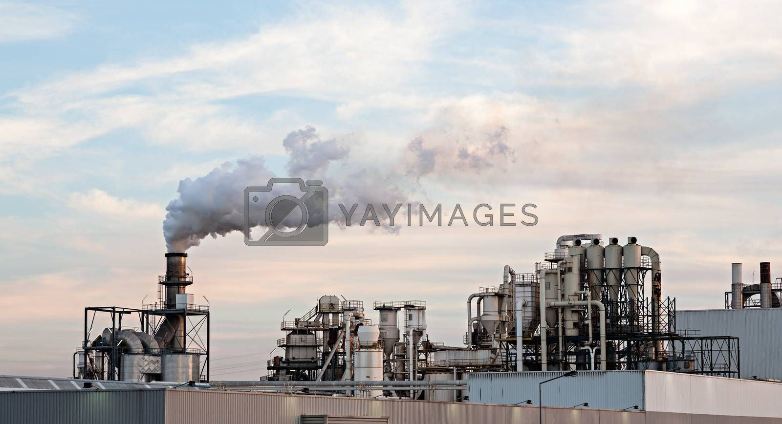 Photo of a cellulose / paper factory at sunset. Portugal.