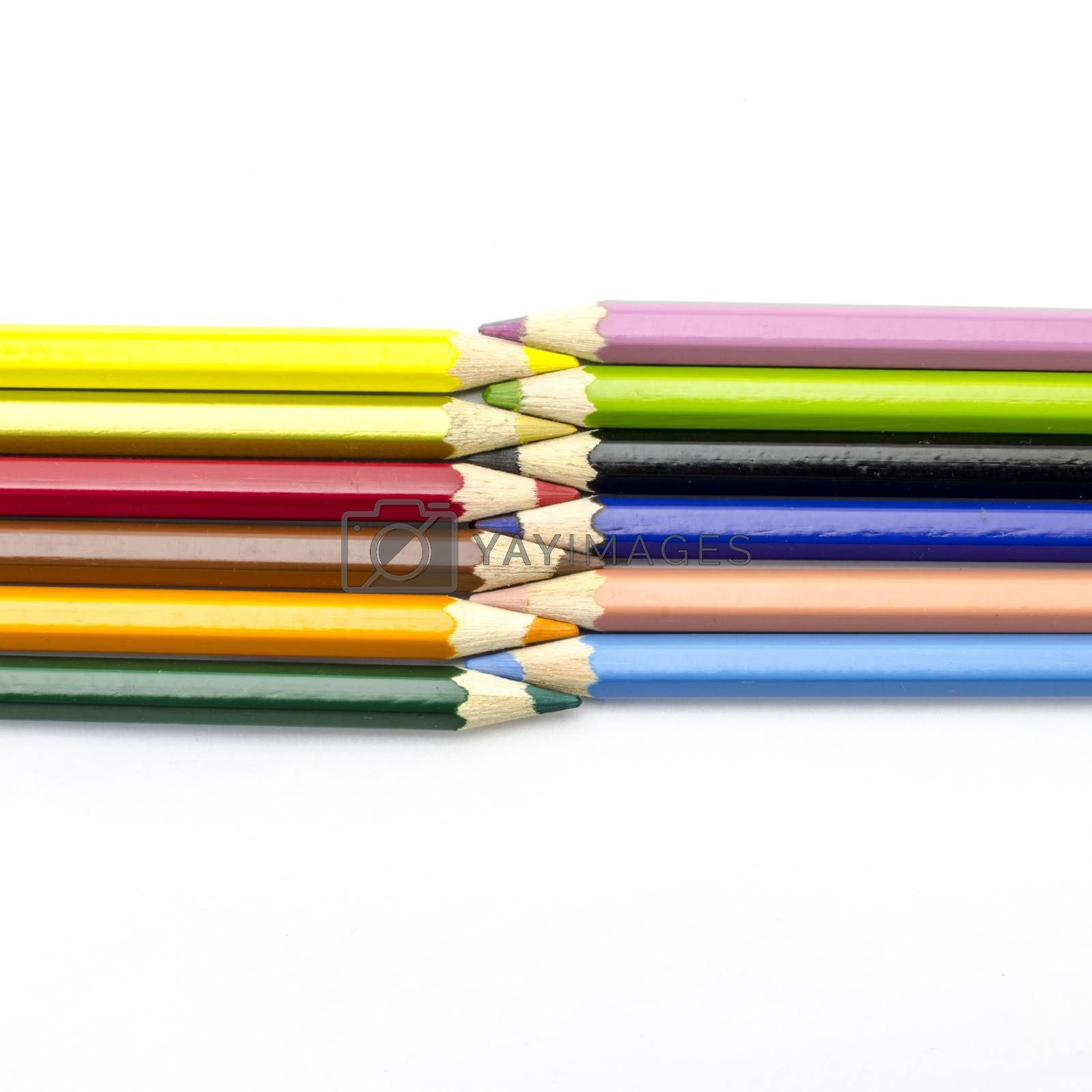 color pencils isolated on white by Nisakorn Neera