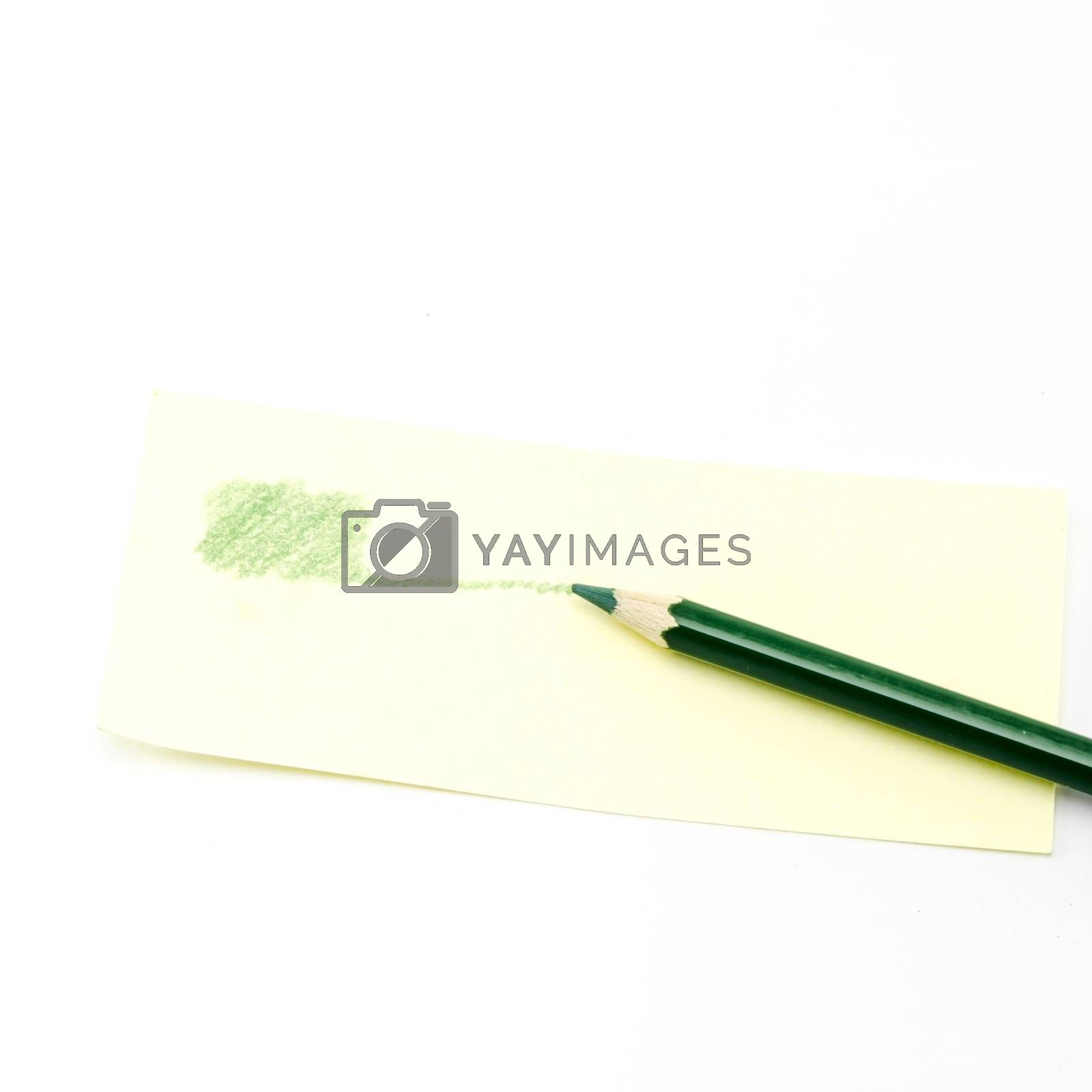green pencil isolated on white by Nisakorn Neera