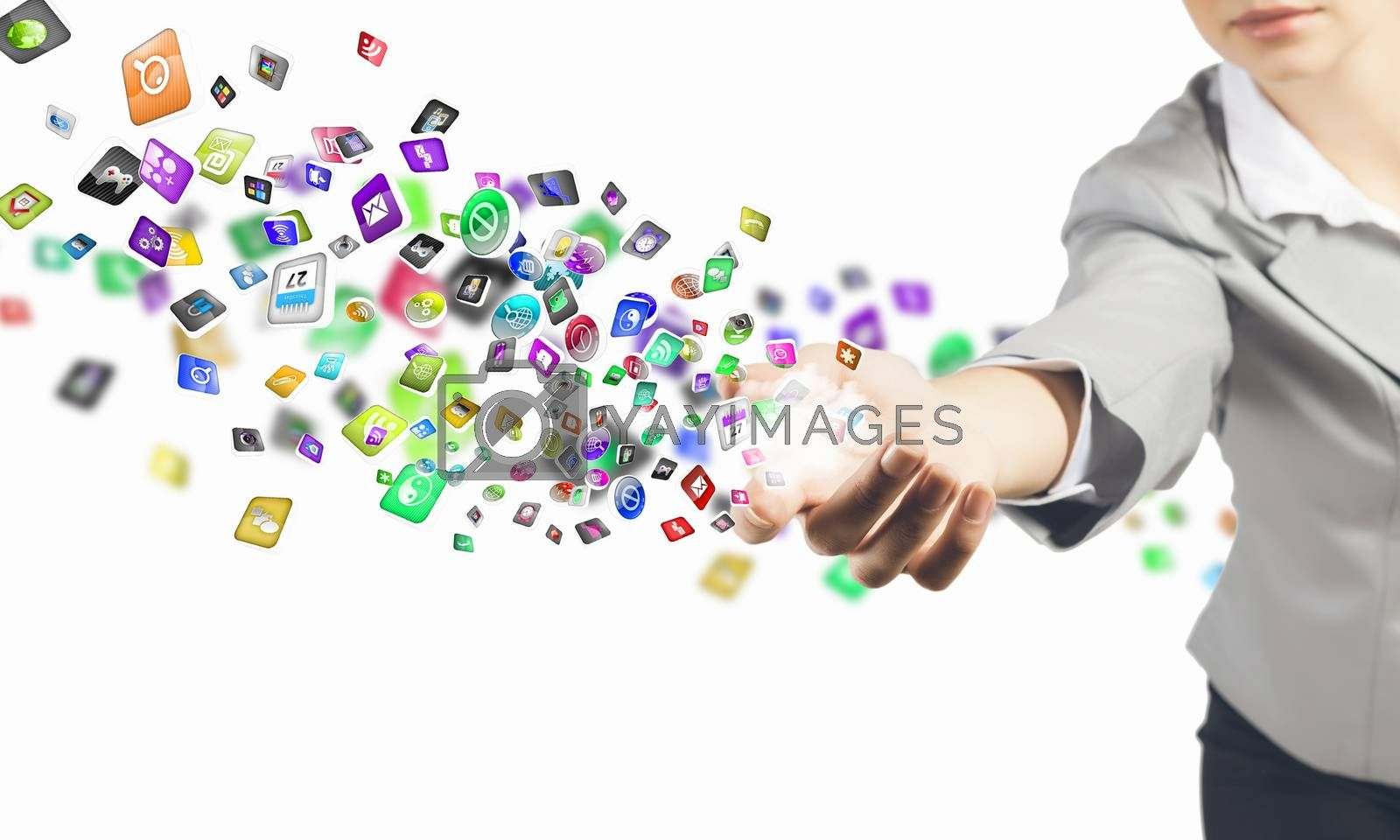 Close up image of businesswoman holding icons in hand