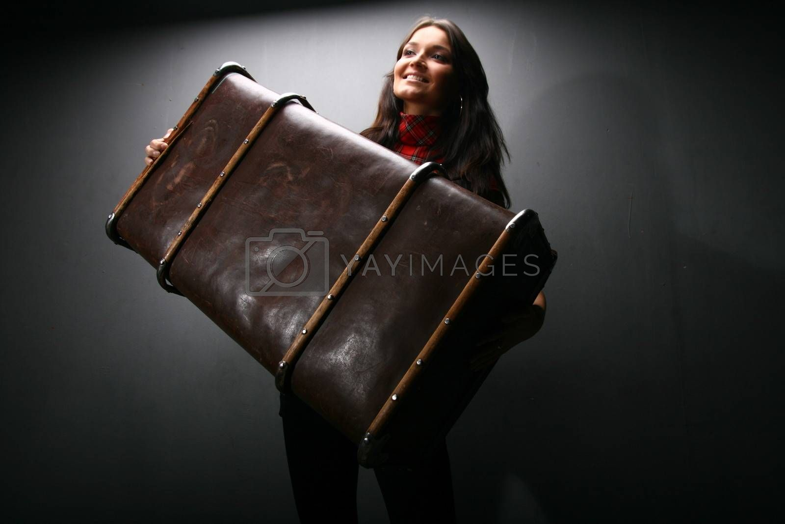traveler girl  Sits on a suitcase wait to go travel