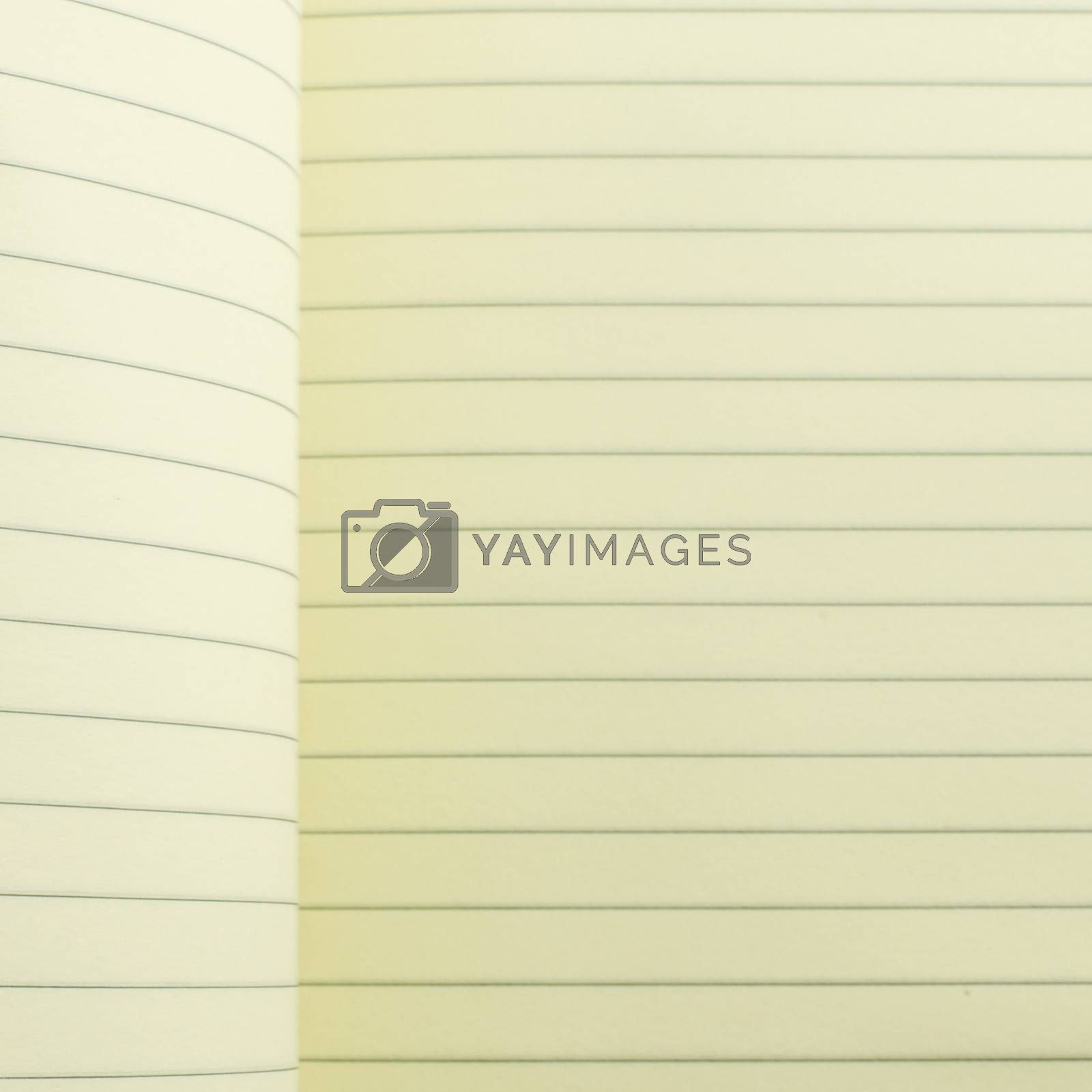 open line notebook on soft brown color by Nisakorn Neera