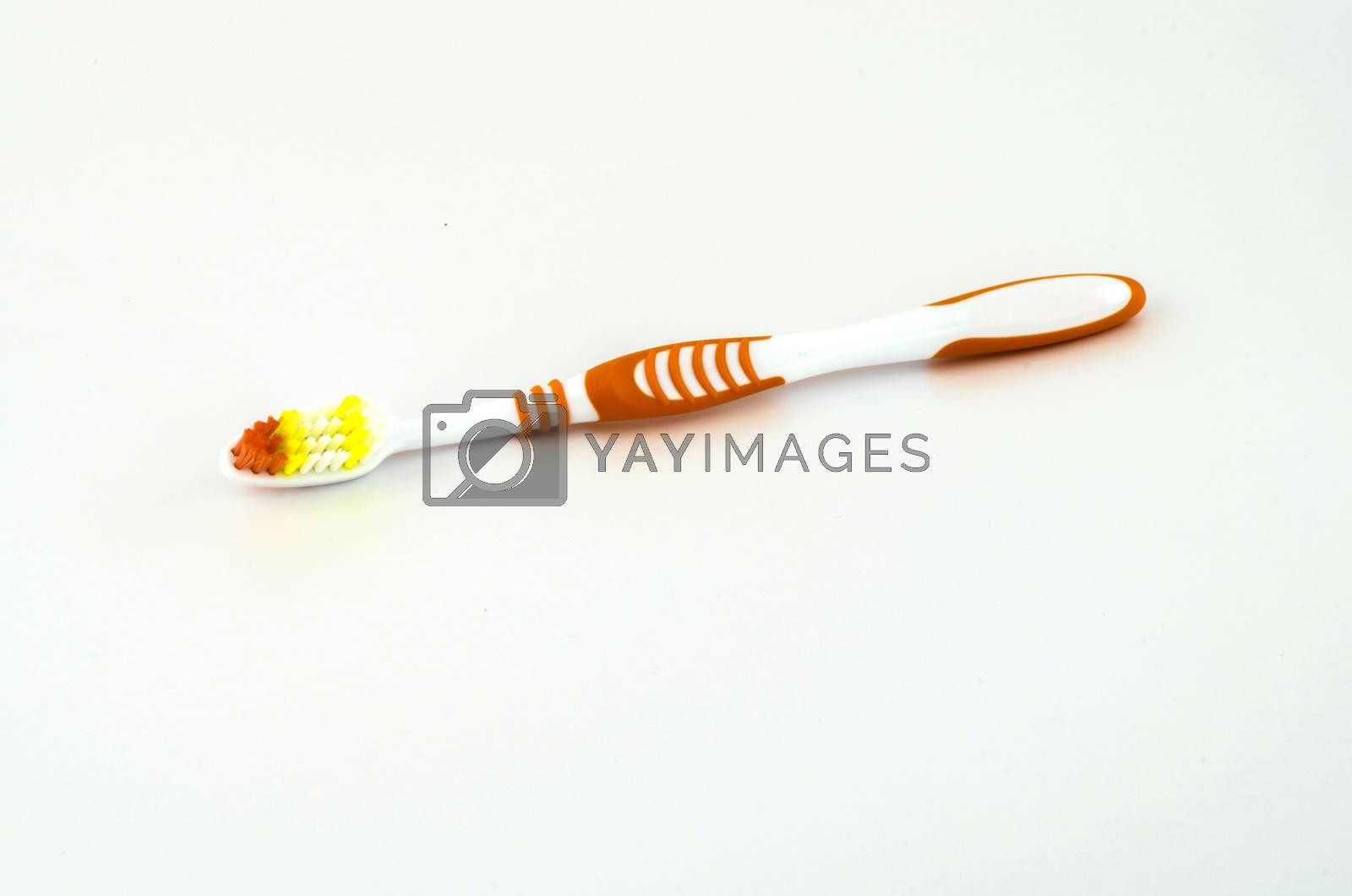 orange tooth brush isolated on white background