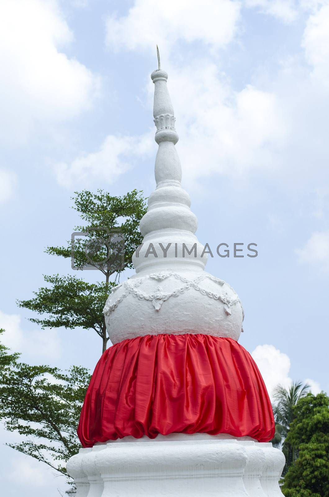 white stppa temple in thailand on sky background