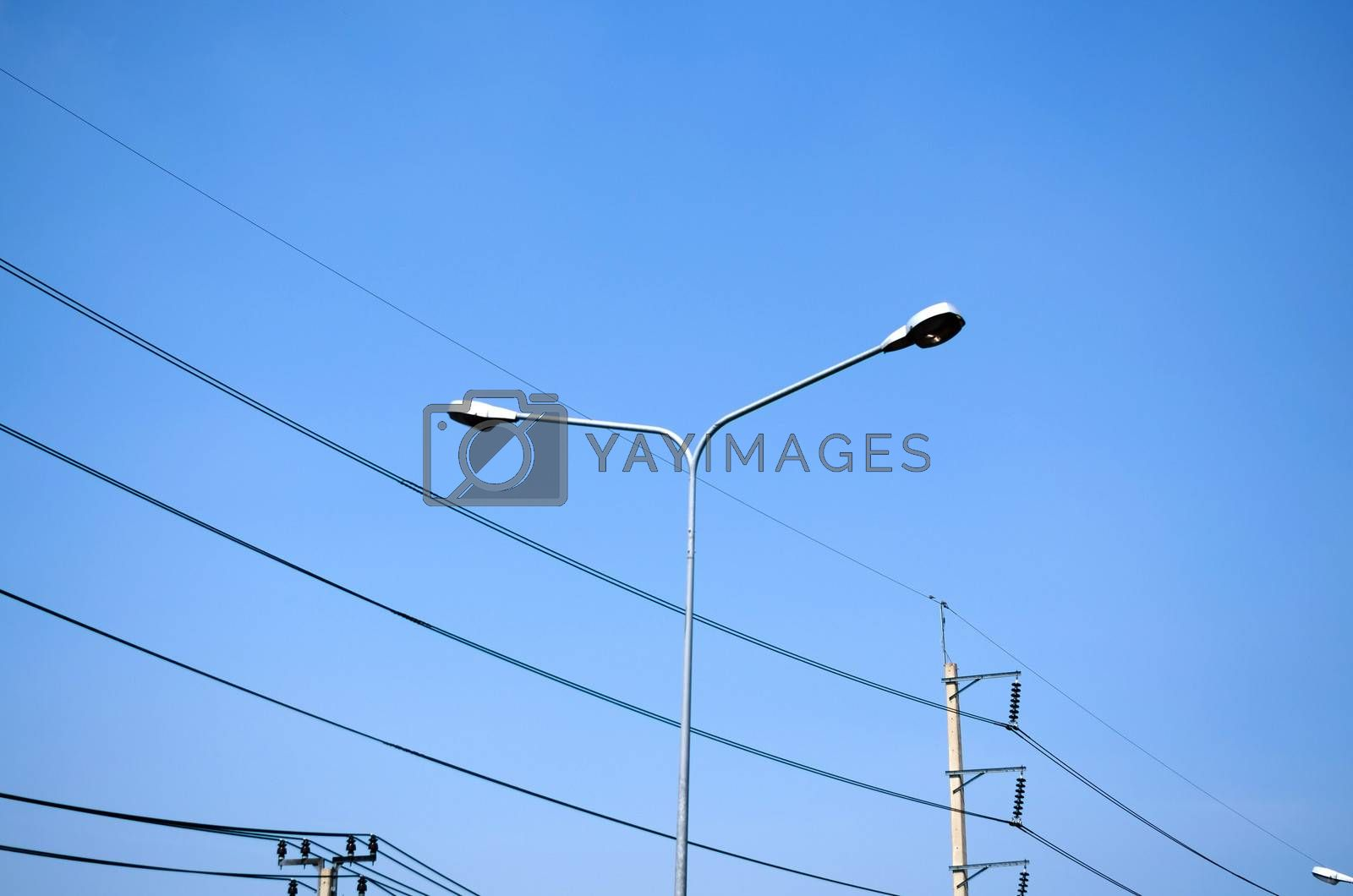 street light and Electricity post on blue sky
