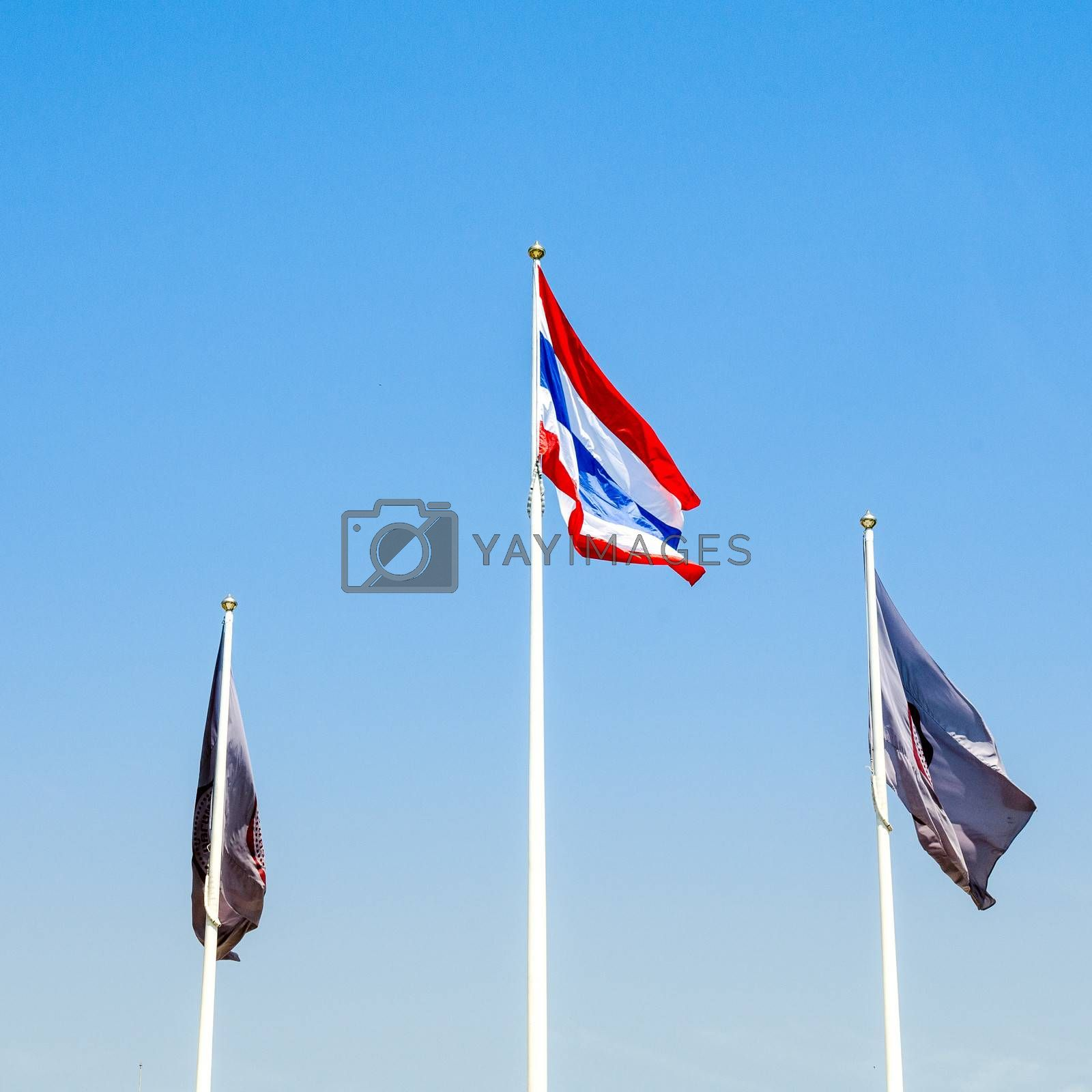 Thai flag with two another flag and bule sky background
