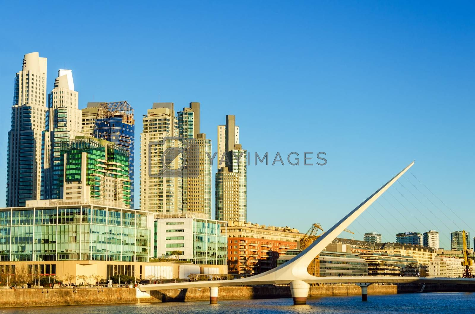 Skyscraper and the Women's Bridge in the upscale neighborhood of Puerto Madero in Buenos Aires