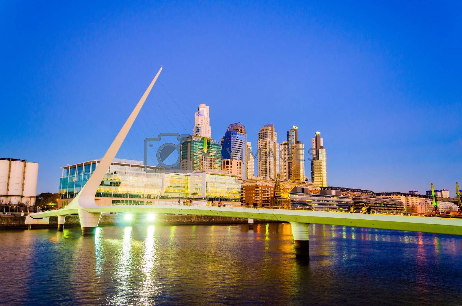 Women's Bridge and upscale skyscrapers at night in Puerto Madero neighborhood of Buenos Aires