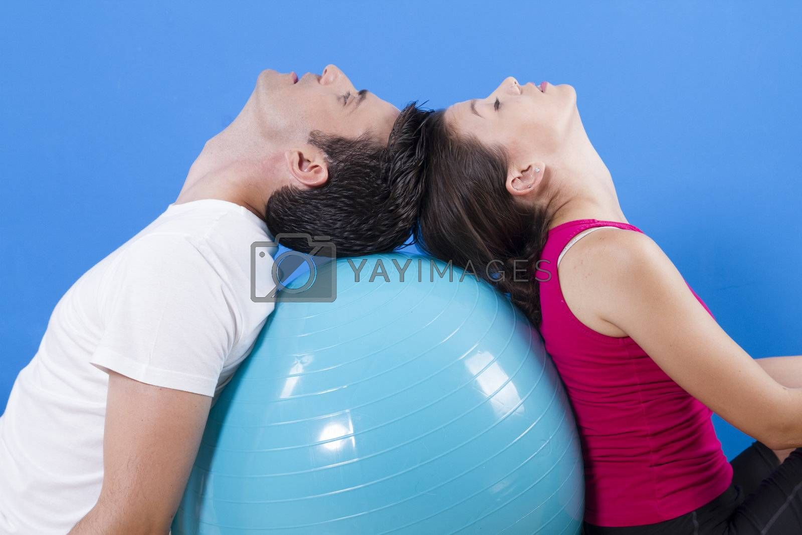 Beautiful athletic couple with fitness ball.