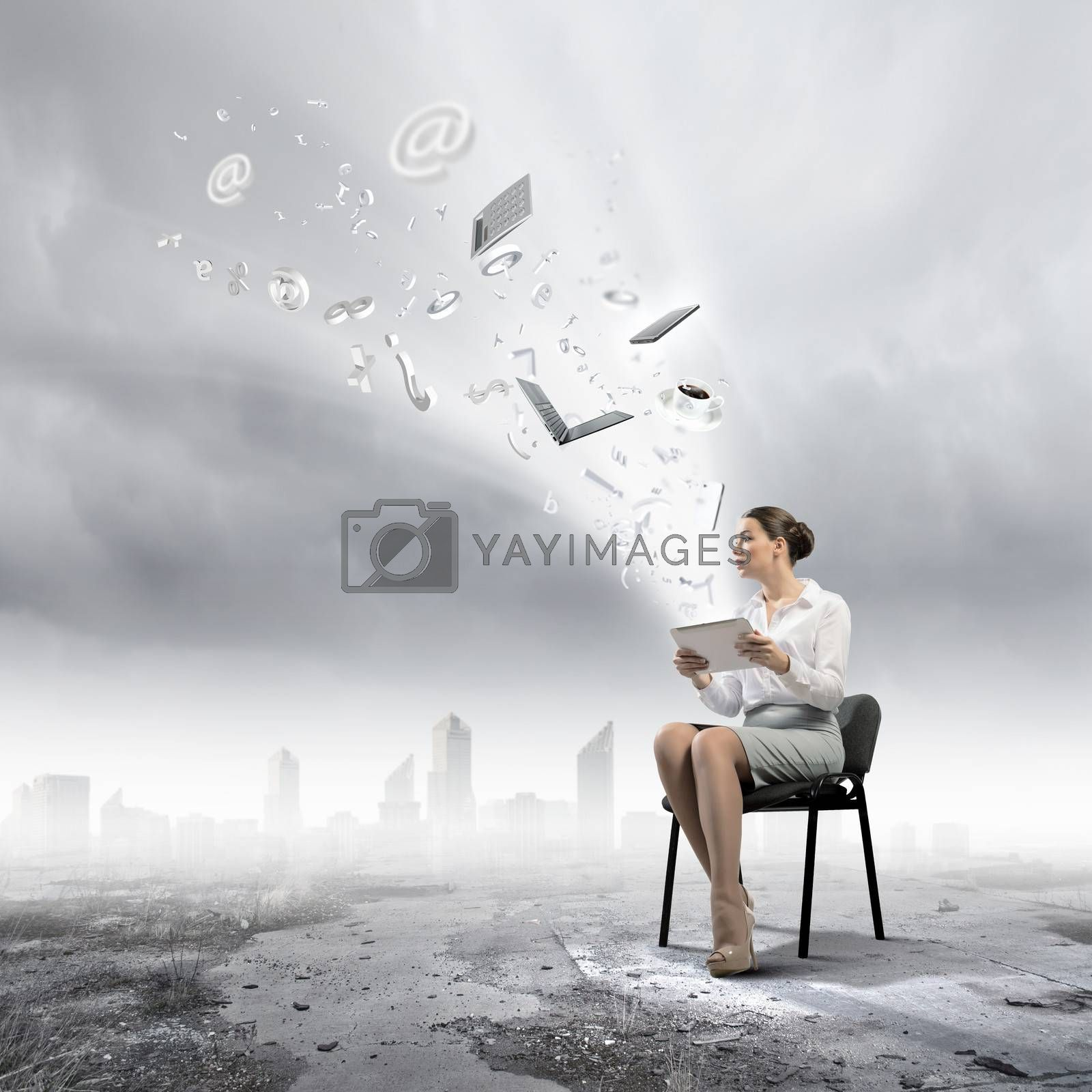 Image of businesswoman sitting on chair with tablet pc in hands